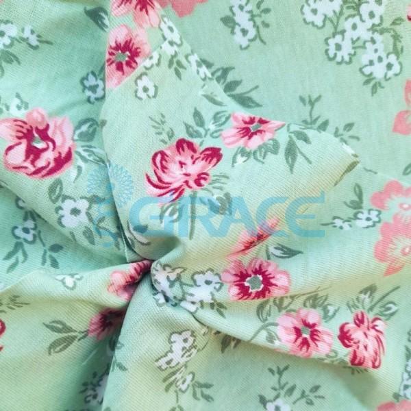 Кулирка джерси - ткань хлопковая трикотажная, светло-зеленая с цветочным узором