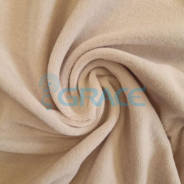 Ткань махра - натуральная трикотажная, эластичная в теплом бежевом цвете