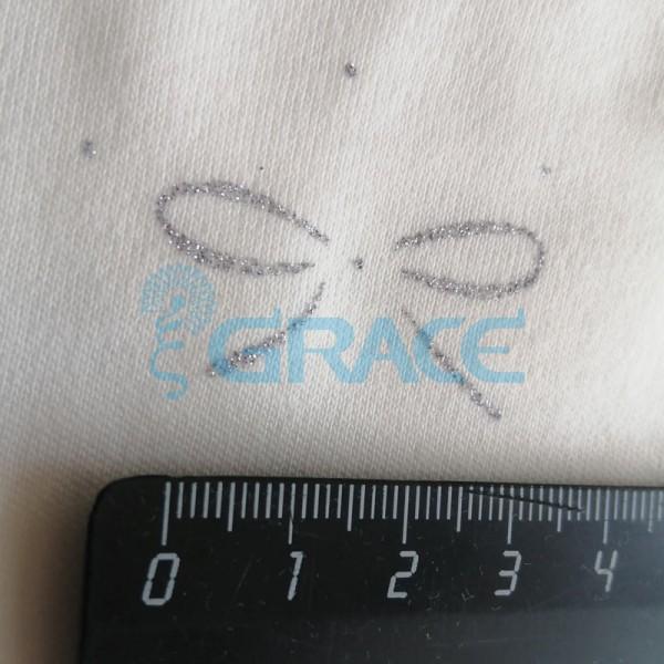 Интерлок с глиттером (блеском) банты на бежевом - ткань хлопковая трикотажная с рисунком