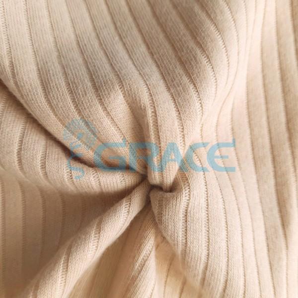 Ткань лапша - натуральная трикотажная, эластичная в бежевом цвете с полосками