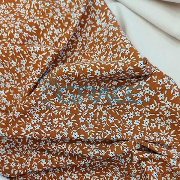 Кулирка джерси - ткань хлопковая трикотажная, с коричневым фоном и узором белые цветы